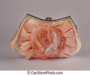 Woman handbag gray background