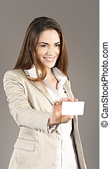 woman handing a blank business card