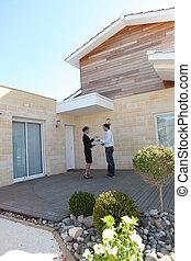 Woman handing house keys