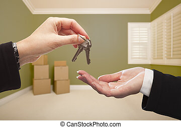 Woman Handing Over the House Keys Inside Empty Green Room