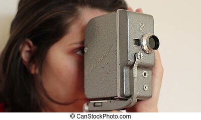 Woman Handles Vintage Camera - Girl is shooting pictures...