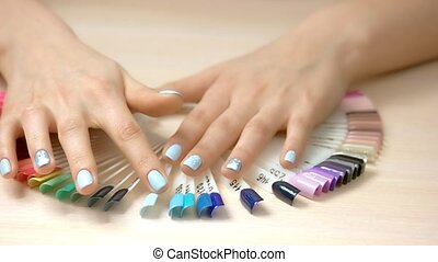 Woman hands and nail samples collection. Well-groomed female...
