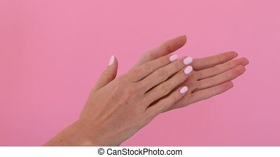 Woman hands clapping applause isolated over pastel pink...