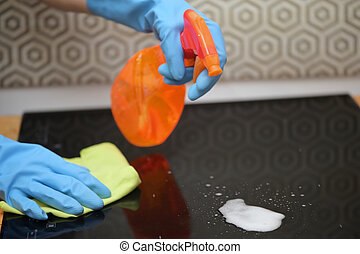 Woman Hands Cleaning A Modern Induction Hob