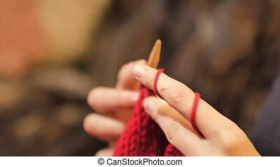 Woman hands close up knitting.