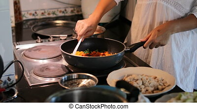 Woman Hands Cooking Vegetables On Frying Pan Closeup, Female Preparing Meal In Modern Kitchen