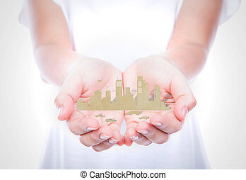 Woman hands hold paper cut of city over body isolated on background.