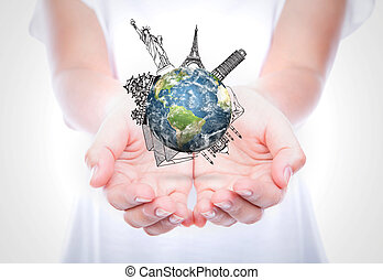 Woman hands hold travel around the world (Japan,France,Italy,New York,India,egypt) over body isolated on background.  (Elements of this image furnished by NASA)