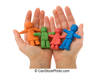 Woman hands holding colorful clay people family