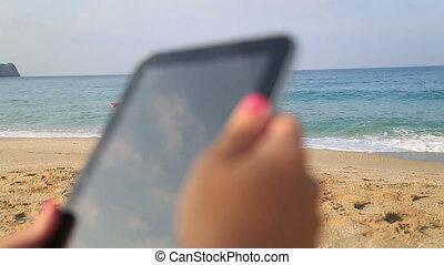 woman hands holding digital tablet