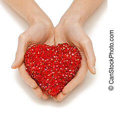 woman hands holding heart - bright closeup picture of woman...