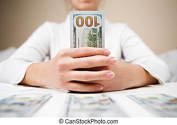 Woman hands holding money