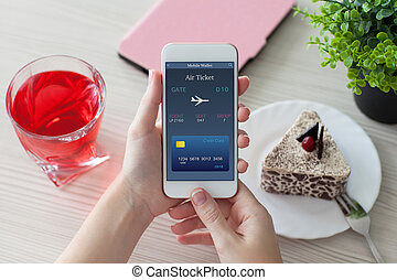 woman hands holding phone with online air ticket in cafe -...