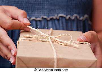 Woman hands holding small package