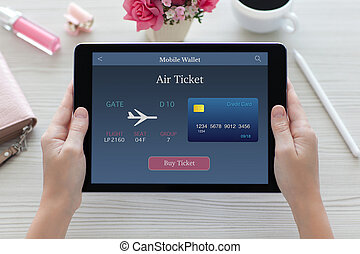 woman hands holding tablet computer with online air ticket...
