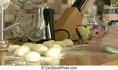 Woman hands kneading dough