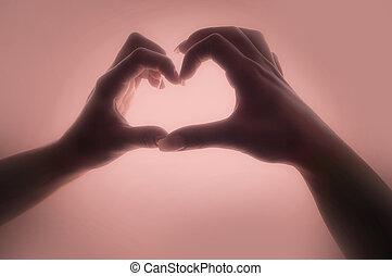Woman hands making a heart shape
