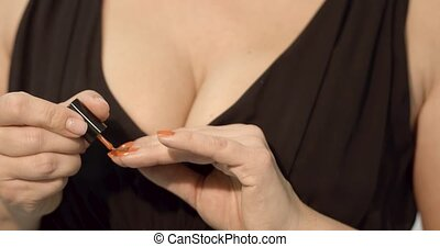 woman hands making manicure to herself - Woman in black...