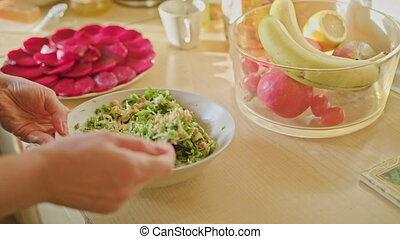 Woman Hands Mixing Salad with Spoon