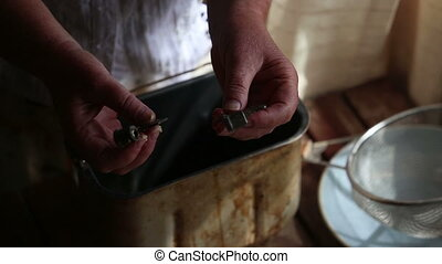 woman hands oils knives in container