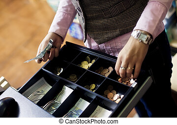 Woman hands on cash register