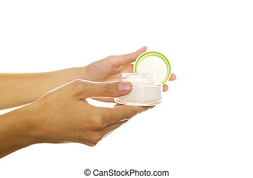 Woman hands opening a bank cream