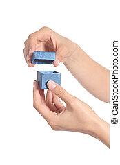 Woman hands opening a little gift box