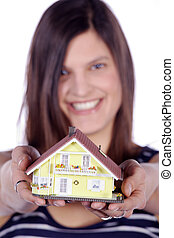 woman hands over house