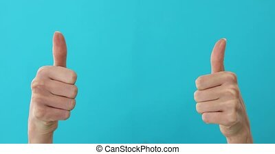 Woman hands pointing on copyspace and showing thumbs up over...