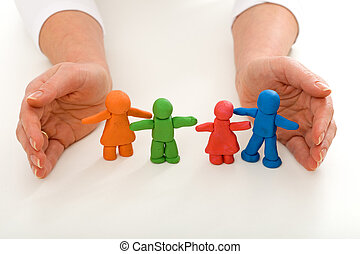 Woman hands protecting clay people family