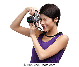 Woman hands retro photographic camera