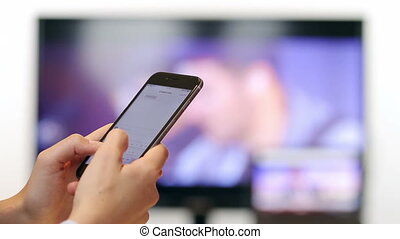 Woman hands texting on smartphone close up