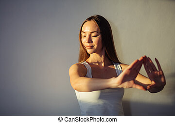 Woman hands together symbolizing prayer and gratitude. Mudra. woman blurred on background, focus on hands