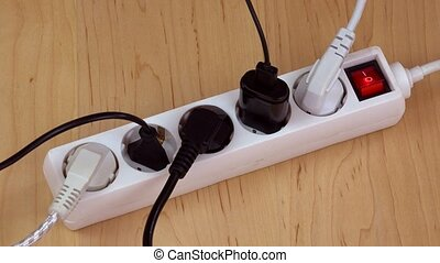woman hands turn off electricity extension switch and unplug...