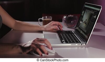 woman hands using laptop, with copyspace in dark space