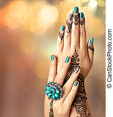 Woman hands with black henna tattoo