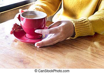 woman hands  with coffee cup