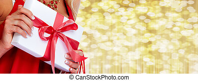 Woman hands with gift.