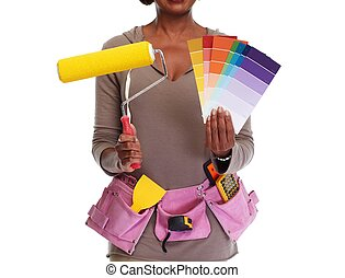 Woman hands with painting roller.