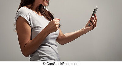 Woman hands with smartphone