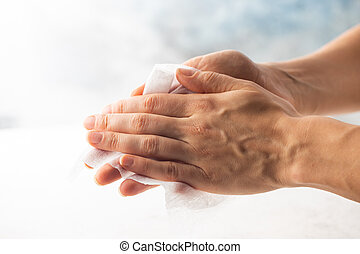 Woman hands with wet wipe