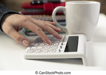 Woman hands working on calculator. Finances, economy, budgetand concept