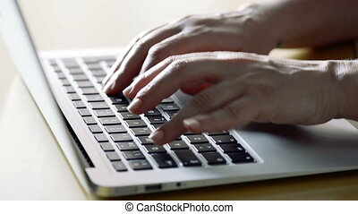 Woman hands working with a laptop.