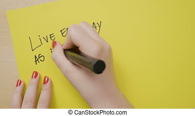 Woman hands writing live each day as if your life has just ...