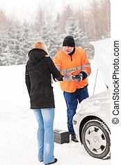 Woman handshake mechanic broken car winter help
