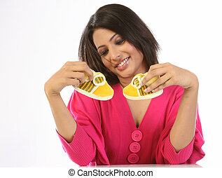 Woman happy with small shoes