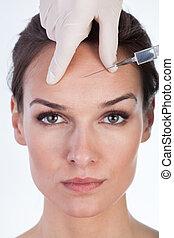 Woman has a botox intervention - Portrait of beautiful woman...
