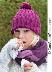 woman has a cold and is cold