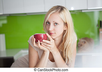 Woman has coffee break at home