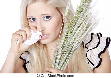 woman has hay fever and sneezes